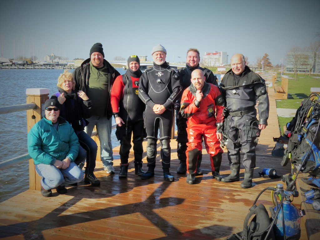 """Today was the annual (after Thanksgiving Day) TURKEY dive by the Muddies. We had a bright sunny day, gentle breeze, air temperature of 41°F when we arrived and went all the way up to 51°F by the time we left. Of course the water temperature was a nippy 38°F and the visibility was either zero or up to 3 feet, once your eyes adjusted to the darkness and if you had a powerful light. Five divers decided to enter the water supported by five others who provided encouragement and surface support to those entering the river. Thanks to Ken R from bringing the """"Toy Box"""" for use as a changing room (w/ heat), club rescue gear and back up O2. After the dive we adjorned back to Wolf's Marine to recharge scuba tanks, have turkey soup then caravanned to the local Pizza Hut for those wanting additional substance."""