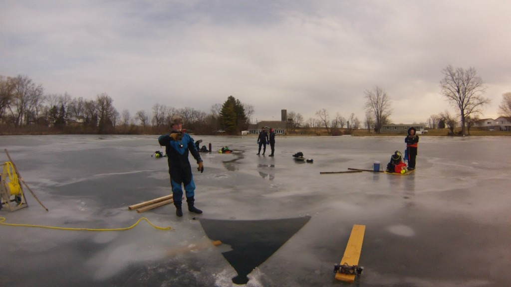 Divers spread out over the ice