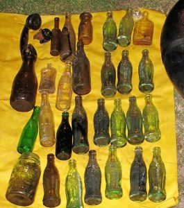 "(Mack) Cache of older small coke bottles. No Christmas cokes and only 3 were local- one was from Texas. The large milk was a nice embosed ""Twin Pine Dairy, Guernsy Milk, T.W. Keirnan""."